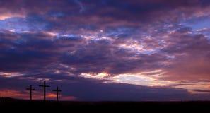 Drei Kreuze und Sonnenuntergang stockfotos