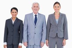 Drei lächelnde Wirtschaftler Stockfoto