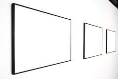 Drei leere Felder auf weißer Wand Lizenzfreies Stockbild