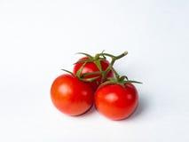 Drei lokalisierte Tomaten Lizenzfreie Stockfotografie