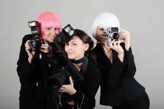 Drei Mädchen mit Kameras Lizenzfreies Stockbild