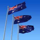 Drei Markierungsfahnen Australien gegen blauen Himmel. illu 3d Lizenzfreie Stockfotografie