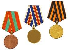 Drei Medaillen getrennt auf Weiß stockfotos