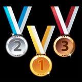Drei Medaillen - Gold, Silber und Bronze Stockfotografie