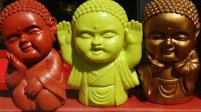 Drei mehrfarbige asiatische Puppegefühle Stockbild