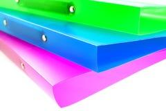 Drei mehrfarbige Faltblätter Stockfotografie