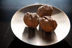 Drei Nüsse schließen herauf künstlerisches stockfoto