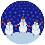 Drei nette Schneemänner Stockbilder