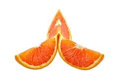 Drei orange Scheiben lokalisiert auf Weiß Stockfotografie