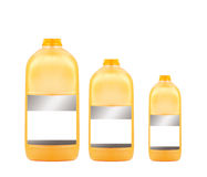 Drei Orangensaftflaschen Stockfotos