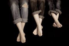 Drei Paare Füße Stockbilder
