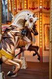 Drei Pferde laufen gelassen auf französischen Karussells Stockfotografie