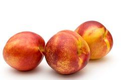 Drei Pfirsiche. Lizenzfreie Stockbilder