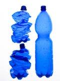 Drei Plastikflaschen zerquetscht Stockbilder
