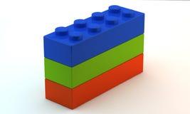 Drei Plastikspielzeugblöcke Stockfoto