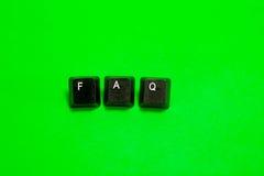 Drei Plastiktasten mit FAQ-Wort Lizenzfreies Stockfoto