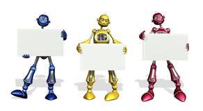 Drei Roboter mit unbelegten Zeichen Stockfotografie