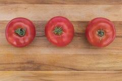 Drei rot, reife Tomaten Stockbild