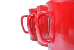 Drei rote Becher auf Weiß Lizenzfreies Stockbild