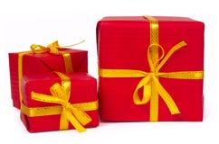 Drei rote Geschenkkästen Stockfotos