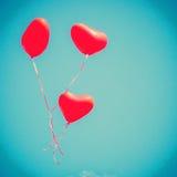 Drei rote Herz-förmige Ballone Lizenzfreie Stockbilder