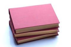 Drei rote interessante Bücher auf dem Weiß Stockbilder