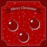 Drei rote Weihnachtsbälle mit einem weißen Schatten Stockbilder