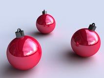 Drei rote Weihnachtskugeln Stockfoto