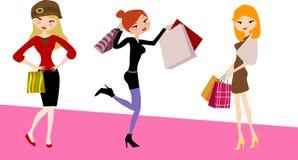 Drei schöne Mädchen auf einem Einkaufen lizenzfreie abbildung