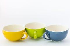 Drei Schalen Farbe des Kaffees Lizenzfreie Stockfotos