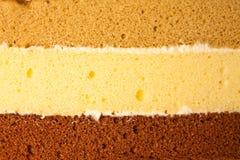 Drei Schichten Kuchen stockfotos