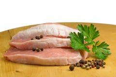 Drei schnitten Schweinefleisch auf einem hölzernen lokalisierten Brett Lizenzfreies Stockfoto