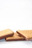 Drei Schokoladenkekse auf einem weißen Hintergrund Lizenzfreies Stockfoto