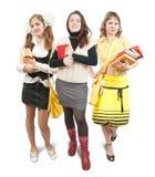 Drei Schulmädchen oder Kursteilnehmer mit Büchern Lizenzfreie Stockfotos