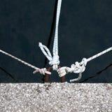 Drei Seile auf Pier Stockfotos