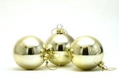 Drei silberne Weihnachtsdekorationen Lizenzfreie Stockfotos
