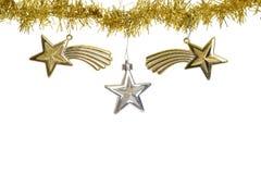 Drei Sterne auf Weihnachtsgoldgirlande Lizenzfreies Stockbild