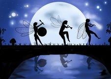 Drei tanzende und singende Elfen Stockbild