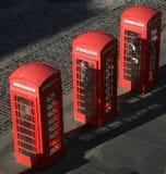 Drei Telefonkästen Stockbild