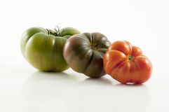 Drei Tomaten selbst erzeugt Lizenzfreie Stockfotos