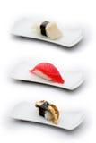 Drei Typen Sushi: Kamm-Muschel, Thunfisch und Aal Lizenzfreie Stockfotos