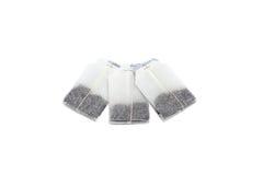 Drei unbenutzte Teebeutel lokalisiert auf weißem Hintergrund Lizenzfreies Stockfoto