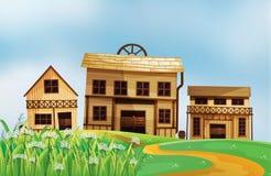 Drei verschiedene Arten von Holzhäusern lizenzfreie abbildung