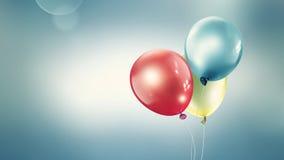Drei verschiedene farbige Ballone stockfotografie