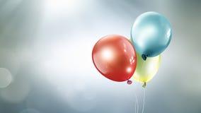 Drei verschiedene farbige Ballone stockbild