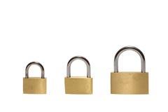 Drei verschiedene Vorhängeschlösser getrennt Lizenzfreies Stockfoto
