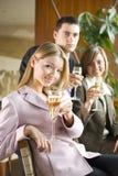 Drei von den Geschäftsleuten, die Toast bilden Stockbild