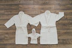 Drei Weiß Bademantel Stockbild
