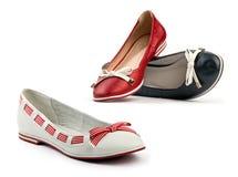 Drei weibliche flache Schuhe Stockfoto