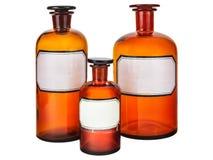 Drei Weinleseapothekenflaschen stockfoto